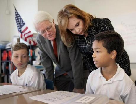 Peter and Carolyn Lynch visited fifth-graders Nico Morreale (left), and Isaiah Almonte.